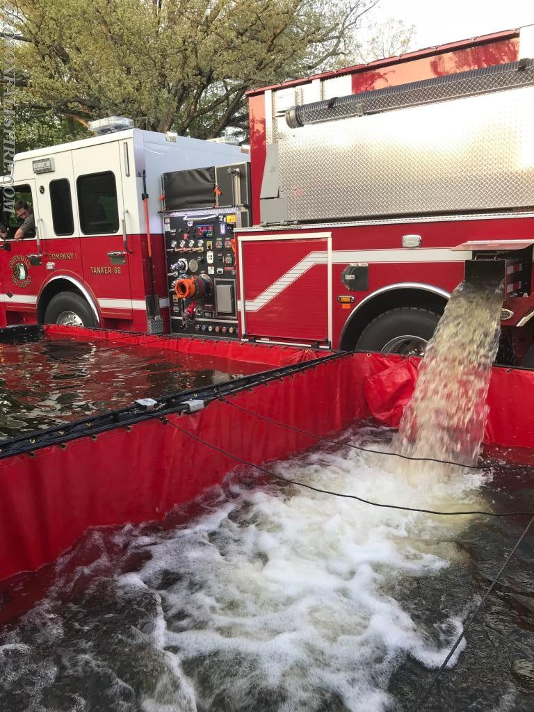 Our newest truck, Tanker 88, dumps water into one of the portable ponds.