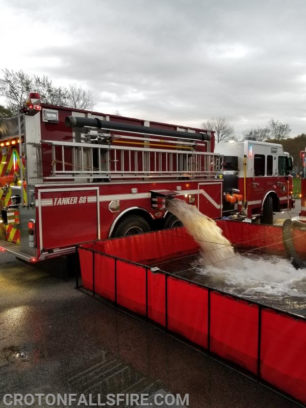 T-88 uses a side dump chute to empty its water tank into the portable pond.