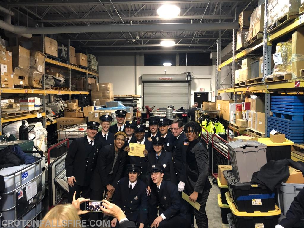 Graduates of a Firefighter One course pose for a picture in a building that stores emergency supplies for Westchester County.