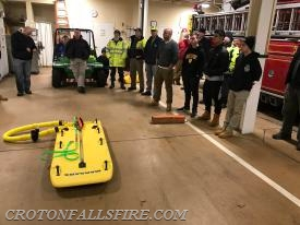 Firefighters look at the ice rescue sled prior to going on the ice.